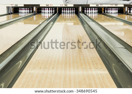 Close up of bowling pins in a row - stock photo