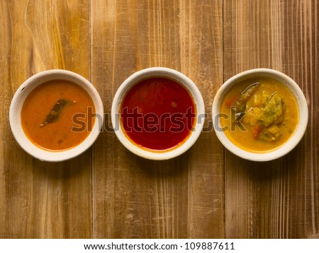 close up of bowls of indian curries - stock photo