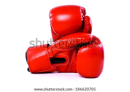 Close Up of Boxing Gloves Red Leather Isolated on white for background, wallpaper or texture.