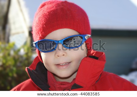 close up of boy in winter - stock photo