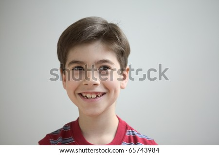 Close up of boy smiling - stock photo
