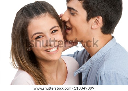 Close up of boyfriend whispering secrets to girlfriend. Isolated on white. - stock photo
