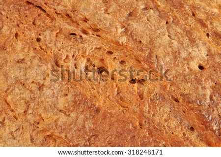 Close-up of bread crust. Texture of Silesian homemade bread for pattern and background. - stock photo