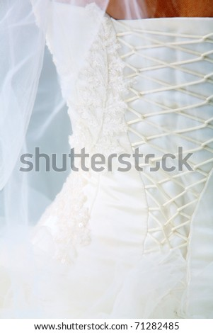 Close-up of bride?s back in corset - stock photo