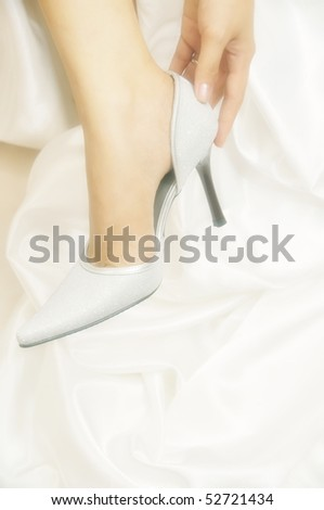 Close-up of bride wearing bridal shoes