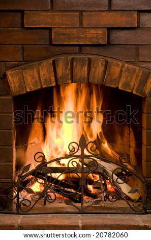Close-up of bright and hot fire burning in chimney on Christmas eve