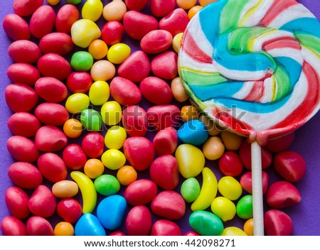 Close-up of bright candies with colorful lollipop.From above - stock photo