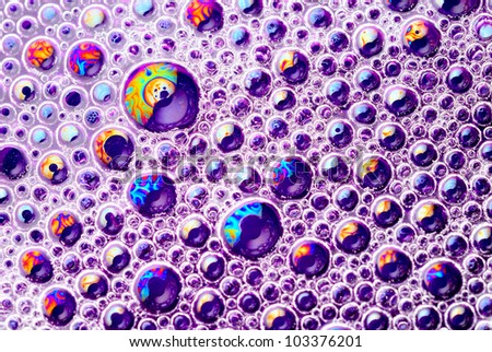 Close-up of brightly colored soap bubbles - stock photo