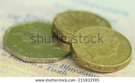 Close up of British Pound coins with bank notes - stock photo