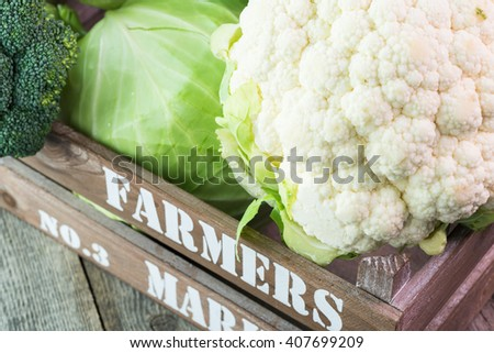 Close up of broccoli, cauliflower and green cabbage in a farmers crate. - stock photo