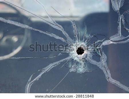 CLOSE -UP OF BROKEN CAR WINDOW - stock photo