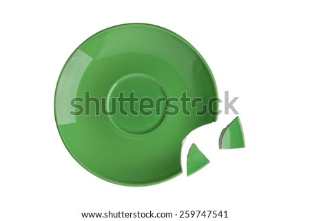 close up of broken green plate on white background - stock photo