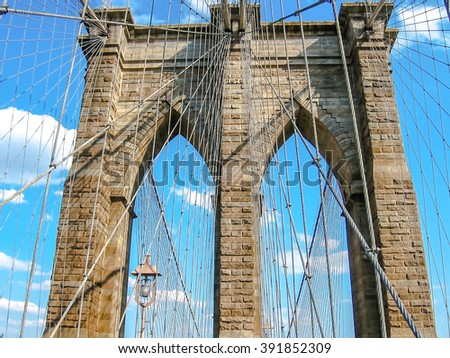 Close up of Brooklyn Bridge with all its characteristic metal wires, New York, United States. - stock photo