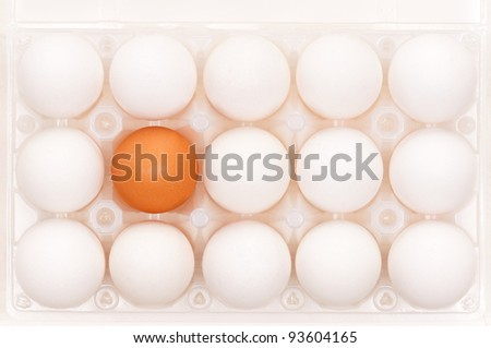 Close-up of brown and white eggs in the plastic box - stock photo