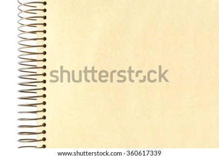 Close up of brown blank notebook with spiral and copy space