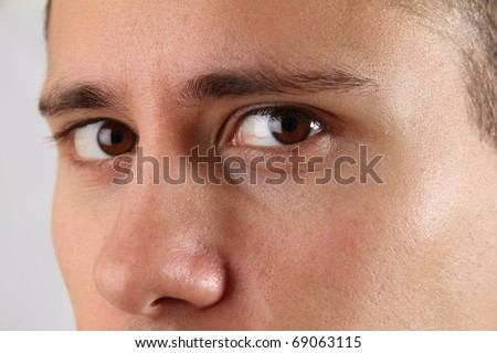 Close-up of brown male eyes - stock photo