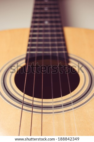 Close-up of brown wooden classical guitar.