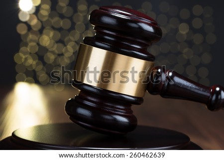 Close-up Of Brown Wooden Gavel With Bokeh Background - stock photo