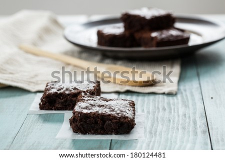 Close up of brownies with a wood spoon - stock photo