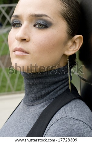Close-up of brunette female looking away from the camera - stock photo