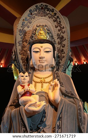 Close up  of buddha statue in a buddhish Temple at Kuala Lumpur Malaysia. - stock photo