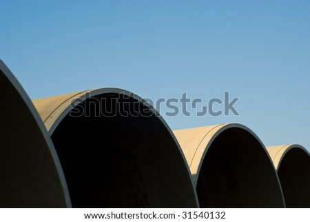 Close up of building sewage pipes with background blue sky - stock photo