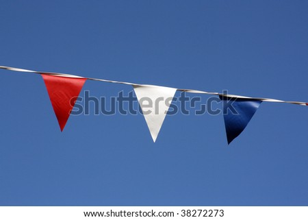 Close up of bunting hanging on Broadstairs seafront, Kent - stock photo