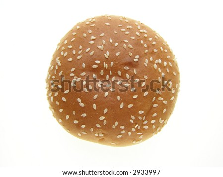 Close-up of burger bun with sesame seeds on white background - stock photo