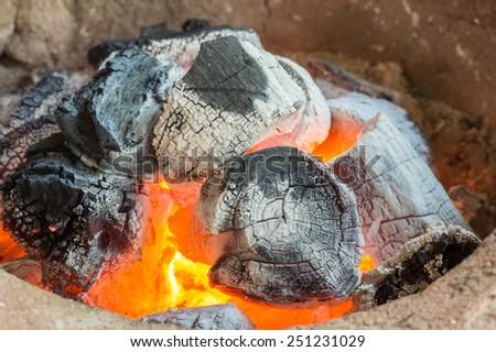Close-up of burning charcoal - stock photo