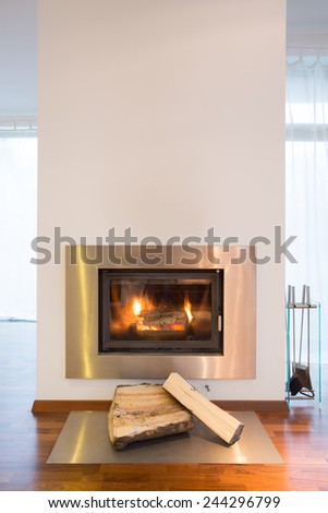 Close-up of burning fireplace in detached house - stock photo