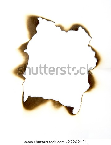close up of burnt paper hole on white background - stock photo