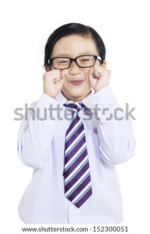 Close-up of business boy pretending to cry on white background