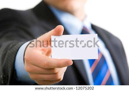 Close-up of business card in business man's hand - stock photo