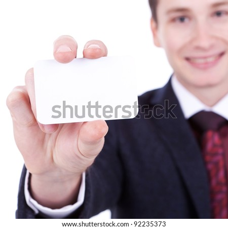 Close-up of business card in business man's hand on white background - stock photo