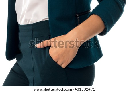 close up of business female hand in pocket of pants isolated on white background