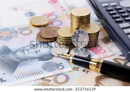 Close up of Business fountain pen and coins stack and china banknote