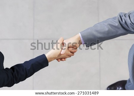 Close up of business handshake between two colleagues
