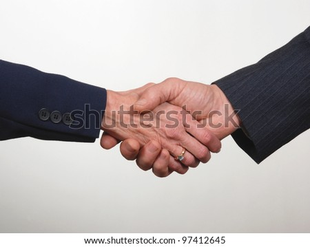 Close up of business handshake, one female  and one male hand - stock photo
