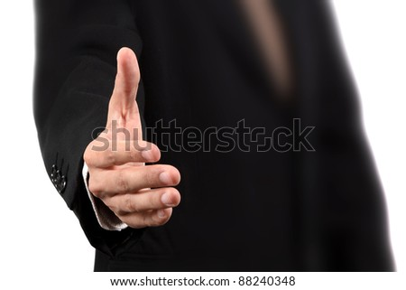 Close up of business man extending hand to shake - stock photo
