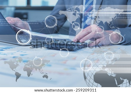 Close up of business man typing on laptop computer with technology layer effect, business globalization concept - stock photo
