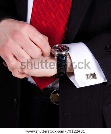 close-up of business man wearing a nice silver watch - stock photo