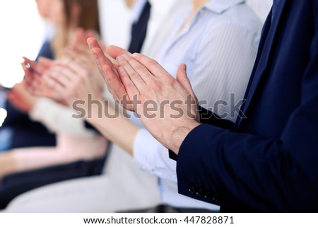 Close up of business people hands  clapping at conference - stock photo