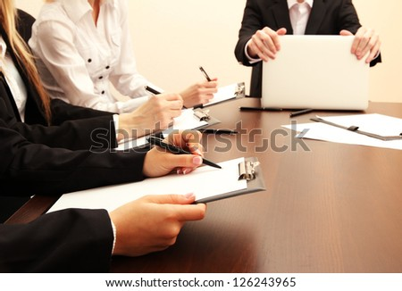 Close up of business people hands during teamwork - stock photo