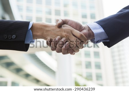 Close-up of business people handshaking - stock photo