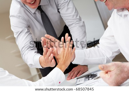 Close-up of business people palms opposite each other symbolizing support and unity - stock photo