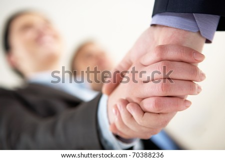 Close-up of business people sharing hands