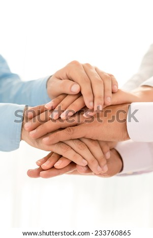 Close-up of business people stacking their hands - stock photo