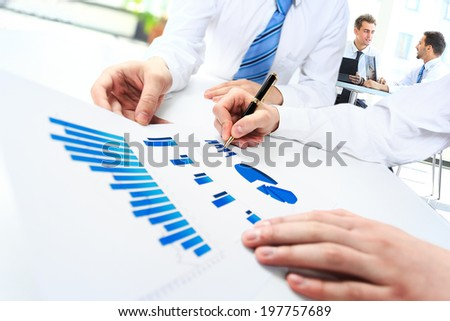 Close-up of business people working with documentation - stock photo