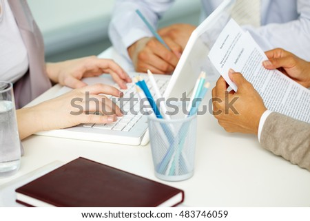 Close-up of business peoples hands working at the table