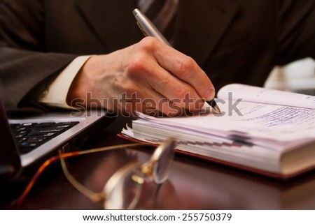 Close-up of business person hand at work - stock photo
